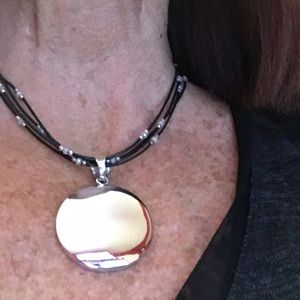 Silpada leather necklace and a Wavy Disc Pendant